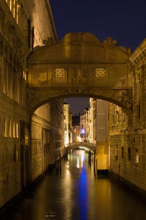 Bridge of sighs (Ponte dei Sospiri) in the night illumination. Venice Editorial