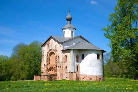Medieval church in honor of sacred Paraskev Fridays on Yaroslavs Court in the sunny May afternoon. Veliky Novgorod, Russia