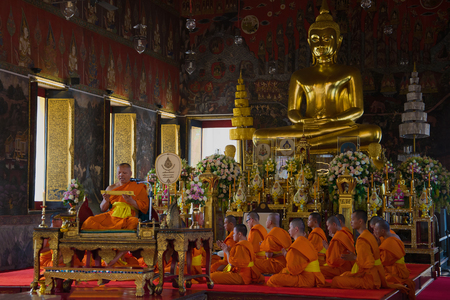 BANGKOK, THAILAND - DECEMBER 31, 2013: Prayer in the Buddhist temple