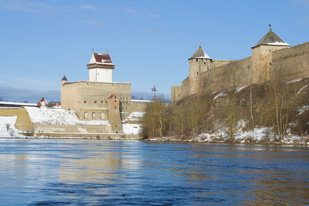 Towers of the Ivangorod fortress and Hermans castle on a sunny March afternoon. Border of Russia and Estonia