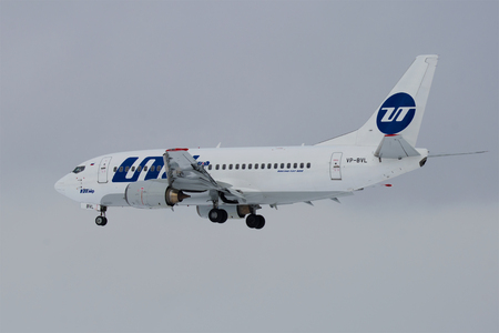 ST. PETERSBURG, RUSSIA - FEBRUARY 25, 2017: The Boeing 737-500 (VP-BVL) of UTair airline on a glide path in the cloudy afternoon
