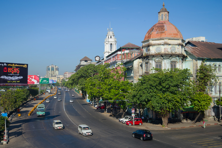 YANGON, MYANMA - DECEMBER 18, 2016: A sunny day in the colonial quarter of Yangon