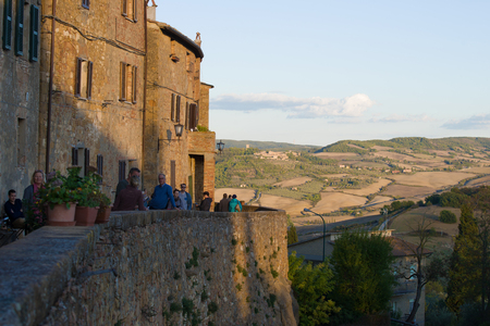 PYENZA, ITALY- SEPTEMBER 25, 2017: September evening on the Punto Panoramico of the medieval Pienza Editorial