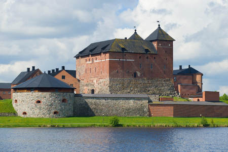 Medieval fortress of Hameenlinna close up on a cloudy July day. Finland