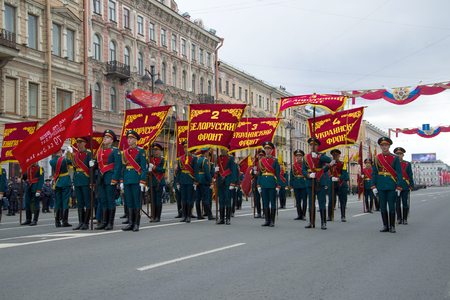 SAINT-PETERSBURG, RUSSIA - MAY 09, 2017: Soldiers of the guard of honor with the standards of the fronts of the Great Patriotic War before the solemn march. Victory Day in St. Petersburg