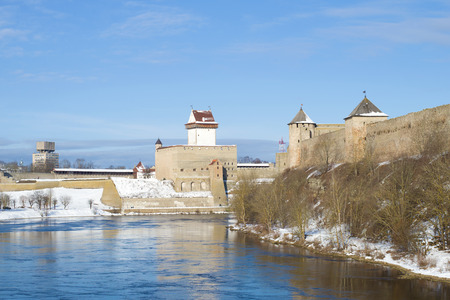 Sunny March day on the Narva River. View of Herman Castle and Ivangorod Fortress. Border of Estonia and Russia