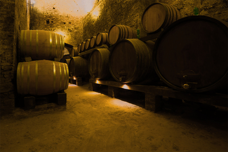 FLORENCE, ITALY - SEPTEMBER 19, 2017: Wine barrels in the ancient cellar of the city of Montepulciano. Tuscany, Italy