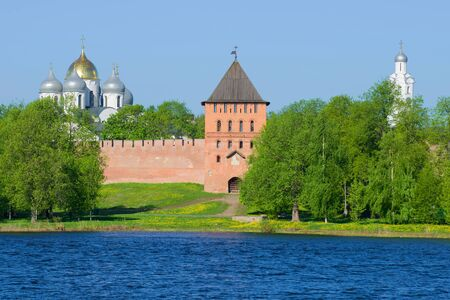 View of the Vladimir tower and domes of St. Sophia Cathedral in the May sunny day. Kremlin of Veliky Novgorod, Russia