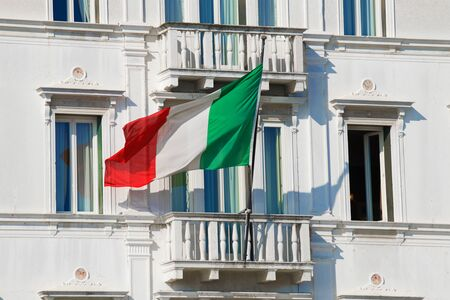 VENICE, ITALY - SEPTEMBER 26, 2017: The national flag of Italy on the balcony of the old house closeup. Venice