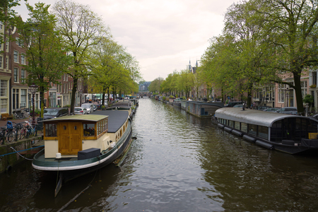 Residential house-boats on the Princes canal on a cloudy. Amsterdam Stock Photo