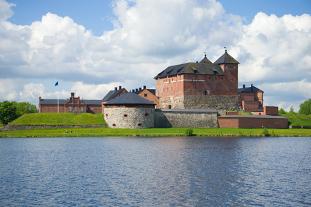The Hameenlinna fortress on the shore of the lake on a sunny June day. Finland Stock Photo