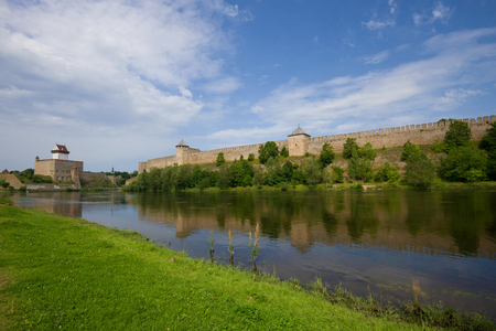 View of Herman Castle and Ivangorod Fortress on a sunny afternoon. Border of Estonia and Russia