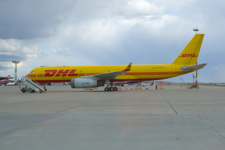 MOSCOW, RUSSIA - APRIL 15, 2015: The cargo aircraft TU-204S (RA-64024) of DHL company parked on the Sheremetyevo Airport on a cloudy April day Editorial