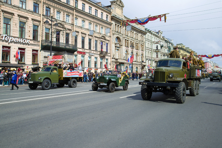 SAINT-PETERSBURG, RUSSIA - MAY 09, 2017: The column of retro transport on Nevsky Prospekt. Victory Day in St. Petersburg
