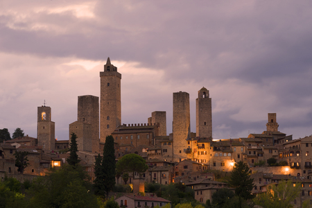 Towers of San Gimignano in the cloudy evening twilight. Tuscany, Italy