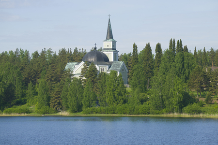 Old Lutheran church on the Church hill in the sunny June afternoon. Ruokolakhti, Finland Banco de Imagens
