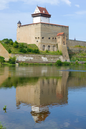 Herman Castle with a reflection on a sunny August day. Narva, Estonia