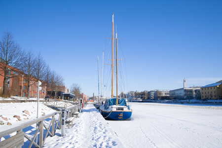 TURKU, FINLAND - FEBRUARY 23, 2018: A sunny winter day on the Aura river Editorial