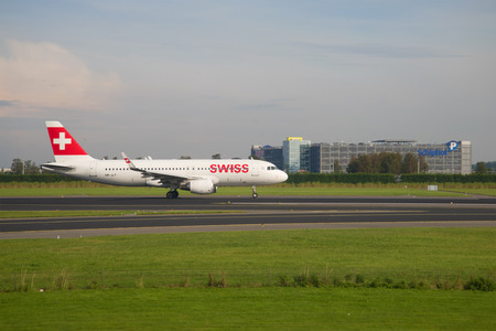 AMSTERDAM, NETHERLANDS - SEPTEMBER 17, 2017: Airbus A320-214 (HB-JLT) Swiss International Airlines on the runway of Schiphol airport