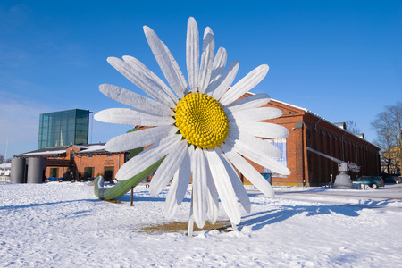 TURKU, FINLAND - FEBRUARY 23, 2018: A giant chamomile flower near the Forum Marinum exhibition center on a sunny winter day
