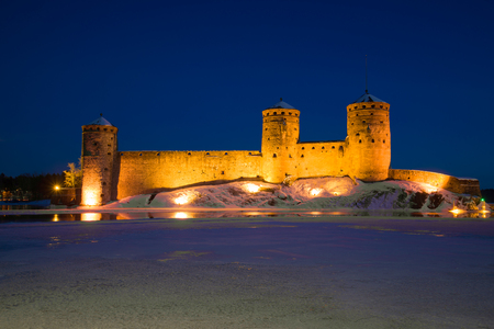 View of Olavinlinns fortress in the March evening. Savonlinna, Finland Stock Photo