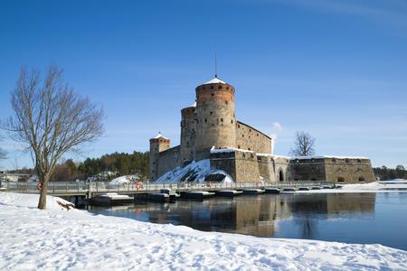 The ancient Olavinlinna fortress in the winter landscape. Savonlinna, Finland