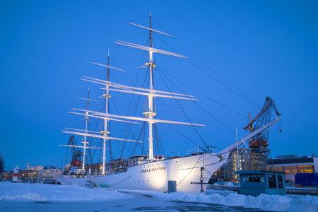 TURKU, RUSSIA - FEBRUARY 23, 2018: Sailboat Suomen Joutsen in the February twilight