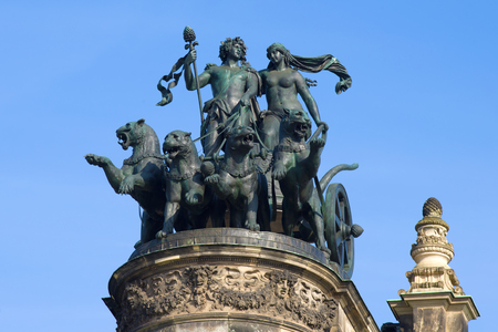 The chariot of the god Dionysius, harnessed by panthers, closeup. Sculptural composition on the pediment of the Semper Opera House, Dresden