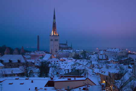 A view of the church of St. Olaf in the gloomy March morning. Tallinn, Estonia