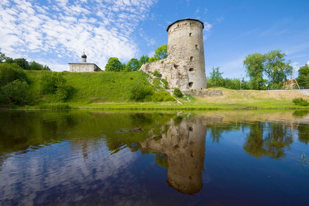 Gremyachaya tower on the Pskova river on a sunny summer day. Pskov, Russia