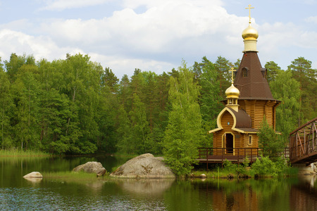 Church of the Apostle Andrew the First-Called on the Vuoksa River on a June cloudy day. Leningrad region, Russia Banco de Imagens