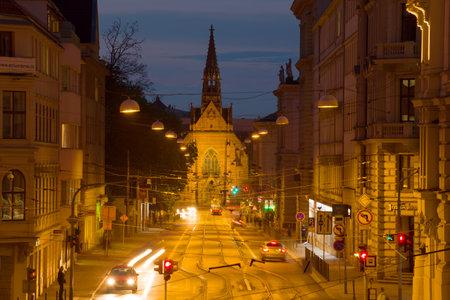 BRNO, CZECH REPUBLIC - APRIL 23, 2018: Church of Jan Amos Komensky (Red Church) in the evening city landscape Editorial