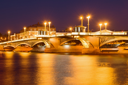 Illumination of the Annunciation bridge on a May night. Saint-Petersburg, Russia
