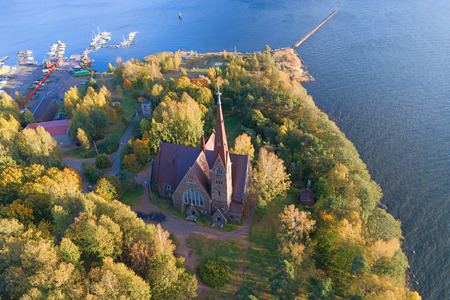 A view from the height on the church of Mary Magdalene in the golden autumn (shooting from a quadrocopter). Primorsk, Leningrad Region