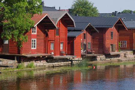 Old wooden barns on the river bank close up on a sunny July afternoon. Porvoo, Finland Stock Photo