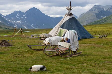 YAMAL, RUSSIA - AUGUST 23, 2018: Children of Khanty reindeer breeders play in sledge