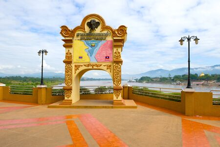 CHIANG SAEN, THAILAND - DECEMBER 18, 2018: Memorial sign on the banks of the Mekong River. Golden Triangle, the border of three countries: Thailand, Myanmar and Laos