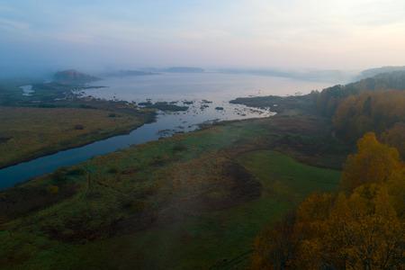 Foggy October morning over Kuchane Lake. Pushkinogorye, Russia Zdjęcie Seryjne