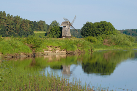 Old windmill on the bank of the river Sorot on the morning of June. Mikhailovskoe, Pushkin Mountains Zdjęcie Seryjne