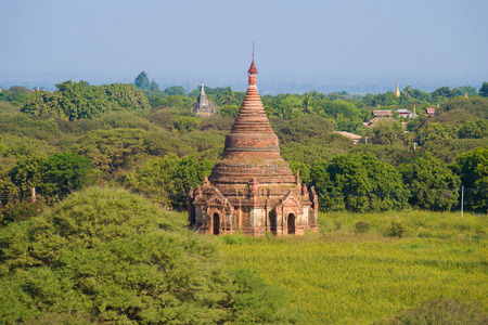 Ancient Buddhist temple in a sunny landscape. Bagan, Myanmar
