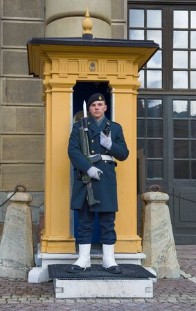 STOCKHOLM, SWEDEN - MARCH 09, 2019: The Swedish soldier on a post at the Royal palace