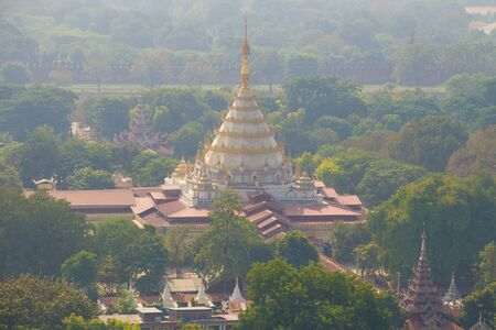View of the Buddhist temple Kyauktawgyi Pagoda in the early morning. Mandalay, Myanmar