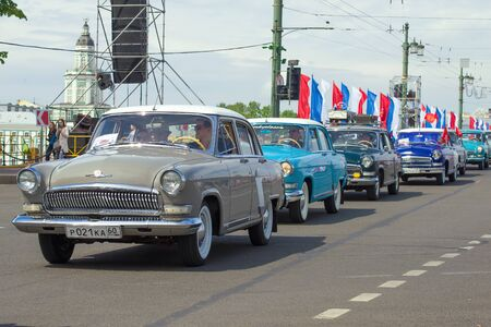 ST. PETERSBURG, RUSSIA - MAY 25, 2019: A convoy of cars ГАЗ-21 Volga on the annual retro transport parade Editorial