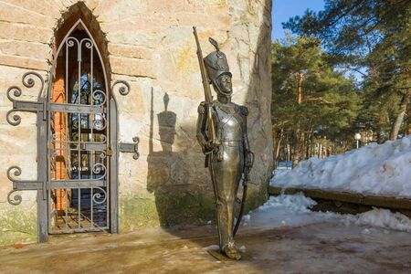 SOSNOVY BOR, RUSSIA - FEBRUARY 15, 2019: Sculpture of a tin soldier at the entrance to the fabulous tower on a sunny winter day. Fragment of the children's town of Andersengrad Editorial
