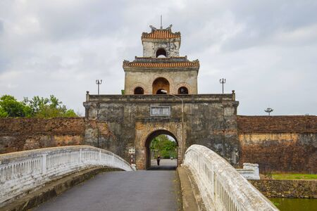 Ancient gate of the old city closeup on a cloudy day. Hue City Citadel, Vietnam