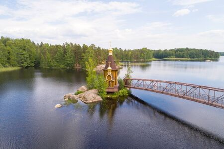 View of the Church of the Apostle Andrew the First-Called on the Vuoksa River on a June afternoon (shot from a quadrocopter). Leningrad region, Russia