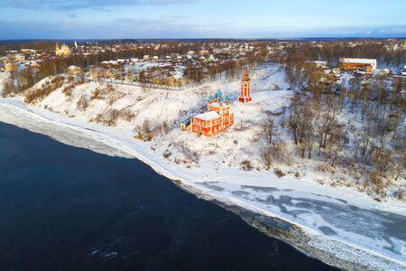 Ancient church of the Icon of Our Lady of Kazanskaya in the cityscape on a winter day (aerial photography). Tutaev (Romanov-Borisoglebsk). Yaroslavl region, Russia 版權商用圖片