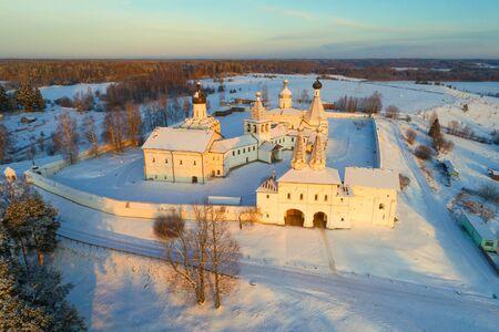View of Ferapontov Belozersky monastery on a December evening (aerial photography). Vologda region, Russia 版權商用圖片