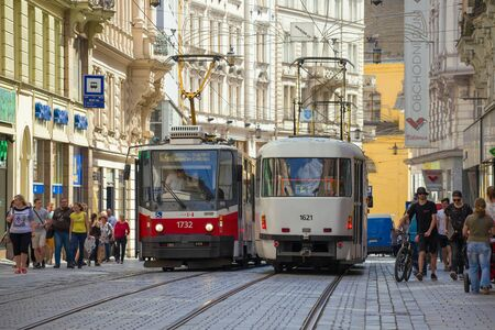 BRNO, CZECH REPUBLIC - APRIL 24, 2018: Two trams on a city street on a sunny day Stock Photo
