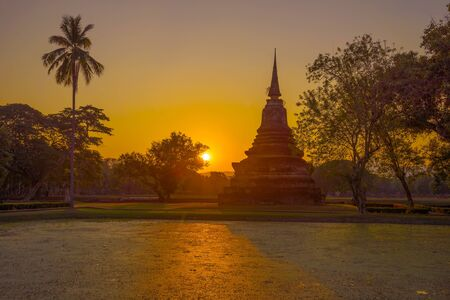 Sunset in the historical park of the city of Sukhothai. Thailand